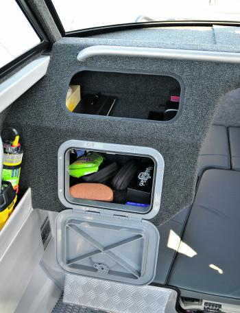 Even the passengers get plenty of watertight storage room in the glove box. Check out all of the gear that can fit in there.