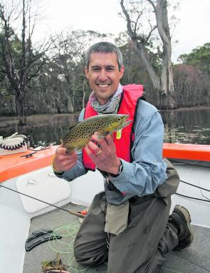 Trout are prime this year in Arthurs Lake, John Clark snitched with fat little fellow from a shallow bay.