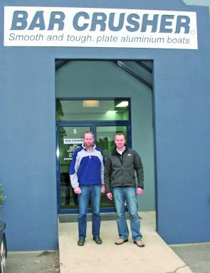 Warren and Peter Cleland stand outside the new Dandenong South Bar Crusher premises.