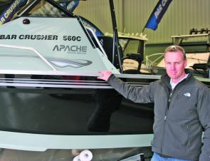 Peter Cleland stands next to the new Bar Crusher Apache 560C – a special 10th anniversary boat.