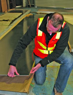 Peter Cleland inspects alloy plate prior to it being placed on the profile cutter.
