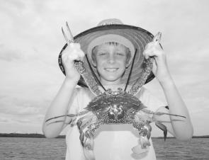 Young Zac Mason displays a fantastic blue swimmer crab, a welcome addition to any seafood meal.