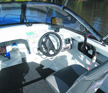 If you like to drive sitting down, the walk-through windscreen is at the right height for you to see over. There is also a small storage compartment up the front for fenders or lifejackets. The test boat came with a Raymarine Dragonfly 7 sounder with CHIR