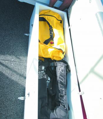 There is plenty of storage room underneath the padded removable rear seat. It's great for storing your safety and fishing gear.