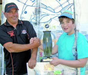 Greg Nixon congratulates Junior Heaviest Fish winner, Adam Petrakos.