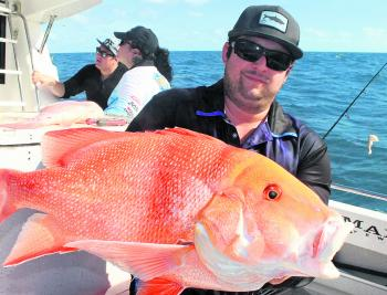 Daniel Claridge exited with his catch of a beautiful red emperor.