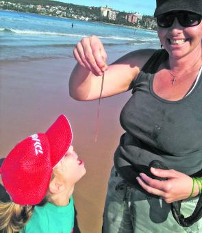 Kellie and daughter Amily catch beach worms at Manly Beach – a great way to have fun.