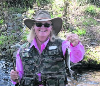 Vicki with her little trout capture.