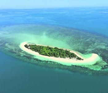 Dove Islet - one of many isolated coral reef enclosed islands.