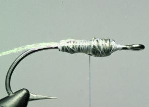 Attach the thread and wind on over the lead body, then tie in the crystal braid as shown.