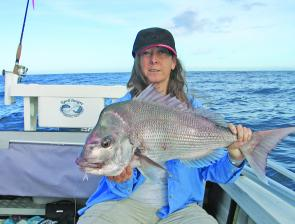 "This 5kg snapper was Deb Peter's PB at the time. She caught the red on a bleeding crystal shad coloured Gambler 5"" Super Stud soft plastic. The rod, as always, is her favourite EGrell S10."