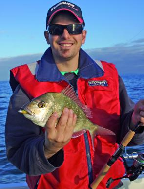 Joe Falcone with a pan-sized pinky snapper he caught on a mango ripple Gulp.