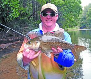Adam Stevens waded one of the local creeks for this frisky bass.