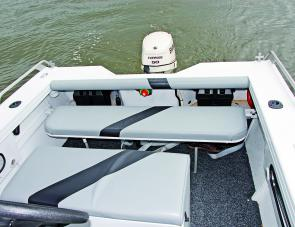 It makes sense in a fishing craft to have a bench seat that can fold down out of the way.
