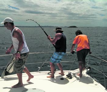 Hooked up to a rampaging small black marlin over very close reef. The best time to target them close to shore is in the middle of summer when the warmer currents are along the coast.