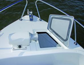 Anchor hatch and winch are easily reached at the Top Gun's bow.