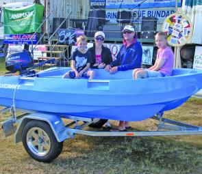 The Wood Family with their 3m Polycraft Tender and 4hp Suzuki prize.