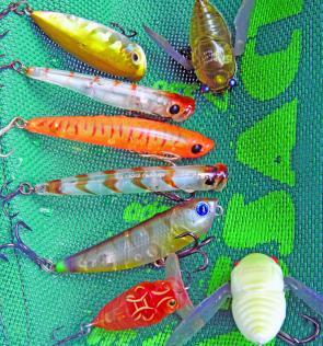 A selection of surface lures for the Summer tackle box. From top right, Megabass Pagani Siglett, Stiffy Popper, Berkley 3B Pop Dog, Bassday Sugapen, Zipbait Skinny Pop, Lucky Craft Sammy 65, River 2 Sea Buggi Pop, Megabass Pagani Grand Siglett.