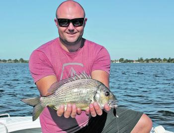 Jason Hodges with a very respectable bream. It's not bad at all for his first bream on a hardbody lure.