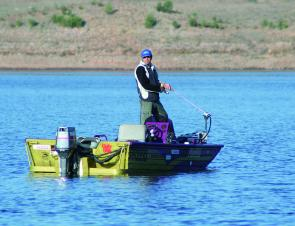 Kerry Ehrlich has all the right gear for targeting Boondooma's deep-schooled bass: a sounder to locate them and the electric motor to hold on the spot.