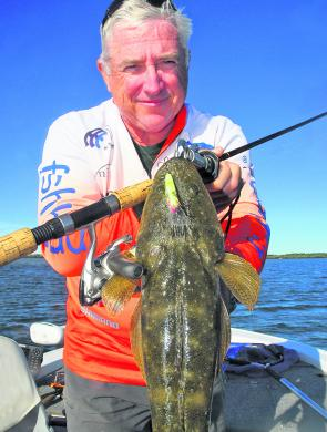 Mark Frendin with a classic Gold Coast combination: A flathead taken on a Lively Lures' Micro Mullet.