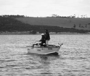 Murray Wilson and Chris Searle land a Bullen Merri bass off Potters Point.
