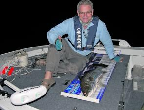 Angler Mike Coles with a fat barra taken on fly tackle taken in Lake Kinchant well after dark.