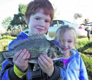Tyler and Olivia with a beautiful bream taken from the flats at Lake Tyers on a hardbodied minnow.