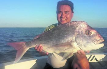 "Danh Duong with his personal best snapper. This fish fell victim to a 4"" ZMan Curly Tail smeared with Pro-Cure scent."
