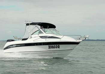 The Revival 580 Sports shows off its sleek lines and a balanced and streamlined cuddy/bimini set-up.