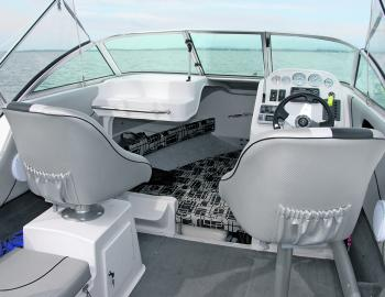This boat has a sturdy forward seating set-up, handy storage locker and ice box under the mate's seat, along with a cushion for an extra front passenger.