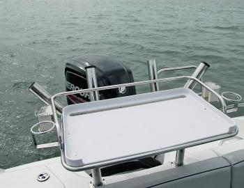 Bait stations are always appreciated in fishing boats. The Revival's comes with a large cutting board plus rod and drink holders.