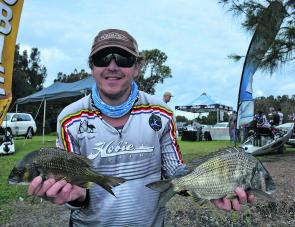Jason Meech with two of the fish that earned him third place, including a 970g fish that took out the Boss Hog Big Bream prize.