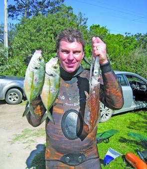 Rob Torelli with a nice catch of spring trevally and squid from Portsea.