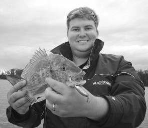 Josh Padmos with a great bream taken on the surface. Bream like these are around throughout the Christmas period and casting poppers is becoming a popular way to catch them.