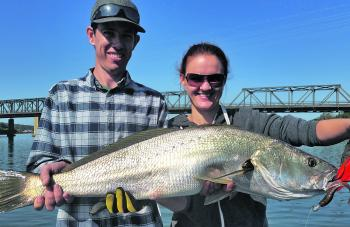 Dion and Lyndall Carle holding Lyndall's first mulloway, these fish always make you smile.