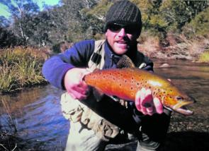 Craig Dawson shows how well conditioned the brown trout were on their spawning run up the Eucumbene River. Fish like this should produce plenty of healthy offspring.