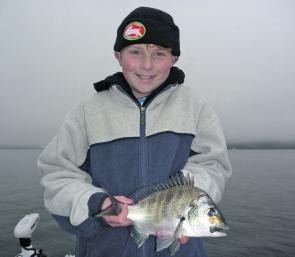 Thomas, 11, caught his first bream on a lure on a day out with his dad, Bruce, aboard Sydney Sportfishing Adventures.