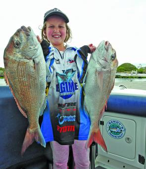 Asha Blake struggles to lift two sizeable snapper from Rhyll.