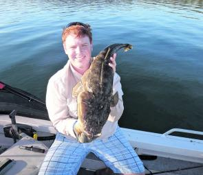 Matt Hammond with a great flathead. This great example of a healthy Lake Mac flathead went 86cm.