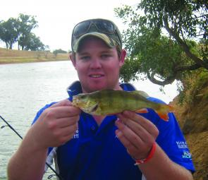 Daniel Knight with a small redfin taken in the main eastern channel on a black and gold lipless crankbait.