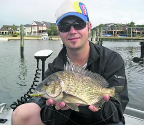 Paul Malov with a nice fish taken on a surface lure fishing in the canals.