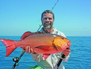 Cooktown has some serious offshore fishing to offer like this 75cm red bass.