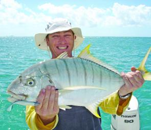 James Burn displaying a golden trevally caught on a soft plastic at Gould Island.