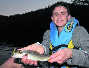 Jared Whitten with a typical sized Lake William Hovell brown trout he trolled from his kayak on a small minnow style lure last autumn.