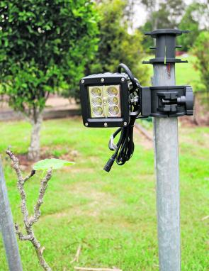 The compact size of the Korr LED flood light and the Korr pole clamp can be assessed from this image.