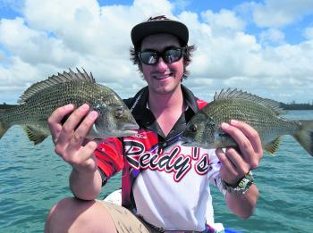 Troy Erland with two bream taken on Astro vibes.
