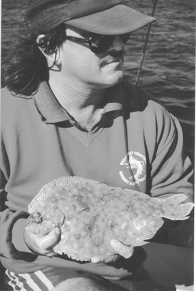 The author with a lovely flounder caught in a local estuary.
