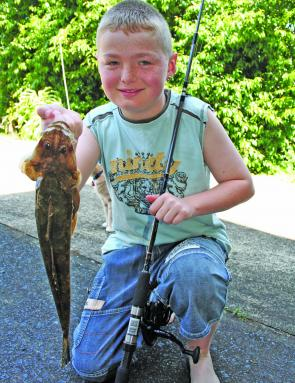 Kevin Poulton, 10, was very pleased with this flathead.