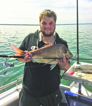 Local angler Chris displays a solid red caught from the North Arm.